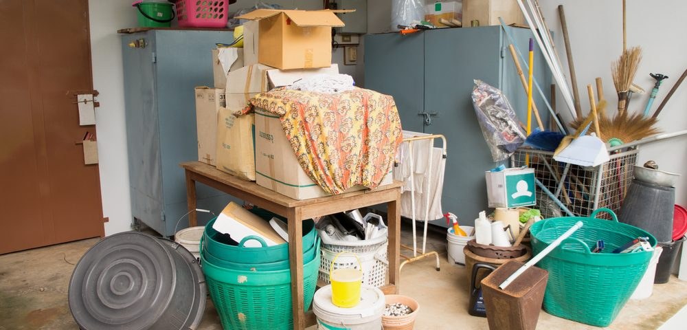 Cluttered garage - It's time to rent a self-storage unit