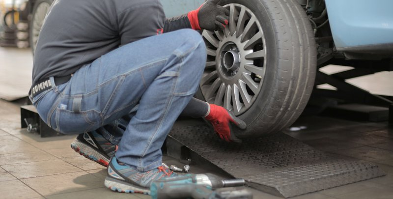 man fixing tire